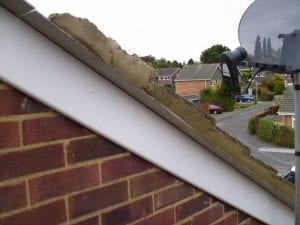 Cemented tiles to an apex/gable can be very difficult to remove, often they need to be cut out.