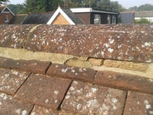 "Poor quality ""buttering up"" of ridge tiles"