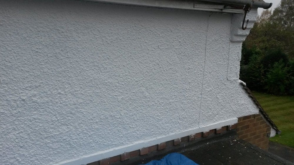 White asonry paint to pebble dash wall