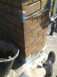Repointing of a chimney stack on a roof