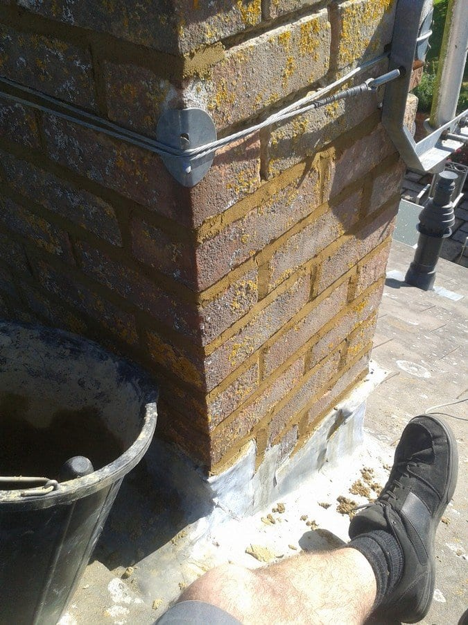 Repointinig of a chimney stack on a roof