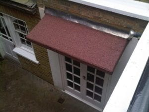 Lead Overhanging Onto Flat Roof
