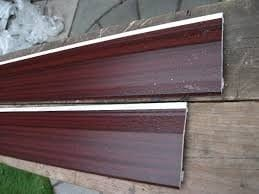 Woodgrain effect brown cladding boards