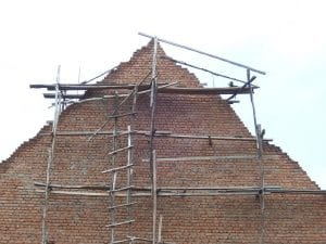 scaffolding to house wall