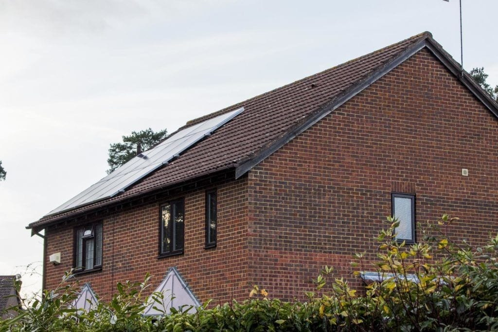 Solar panels fixed to a tiled roof in the United Kingdom