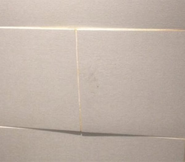 Large wall tiles badly fitted