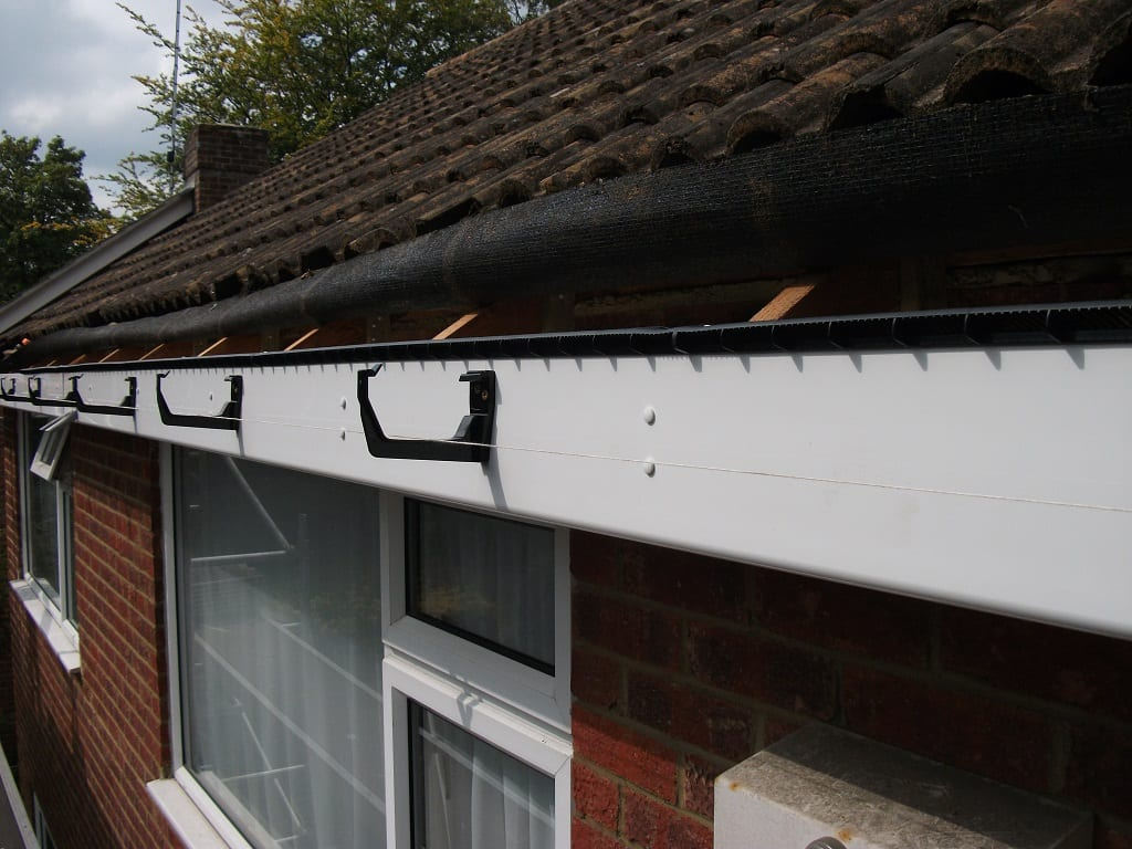 Roofline boards and guttering being installed